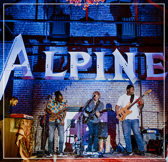 Band playing at The Alpine