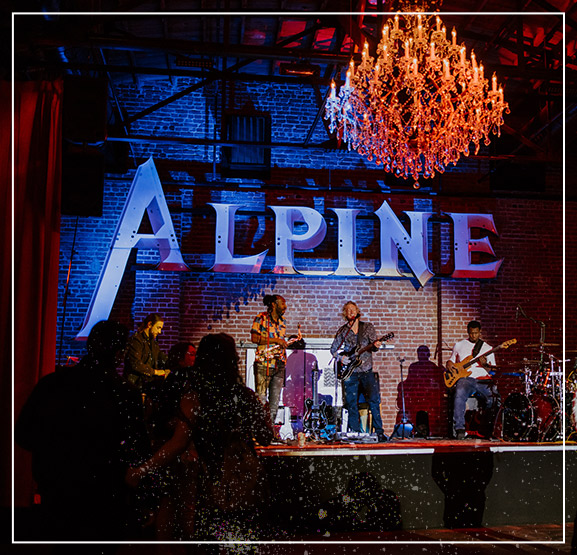 band playing on stage - The Alpine
