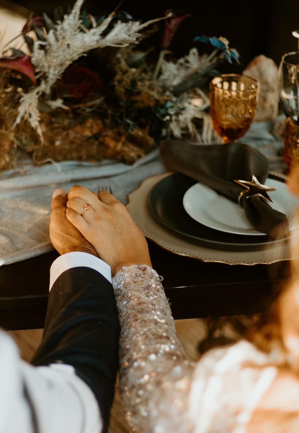 Wedding ring on women holding groom's hand